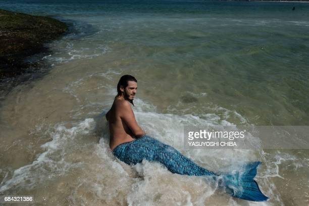 Davi de Oliveira Moreira known as Sereio wears a blue mermaid tail to swim at Ipanema Beach in Rio de Janeiro Brazil on May 3 2017 The 22yearold...