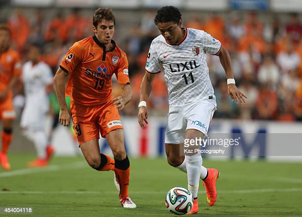 Davi Jose Silva do Nascimento of Kashima Antlers and Dejan Jakovic of Shimizu SPulse compete for the ball during the JLeague match between Shimizu...