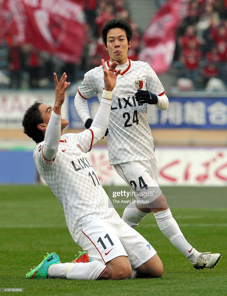 Davi Jose Silva do Nascimento (L) of Kashima Antlers celebrates scoring his team's first goal with his teammate Yukitoshi Ito during the J.League match between Ventforet Kofu and Kashima Antlers at the National Stadium on March 1, 2014 in Tokyo, Japan.
