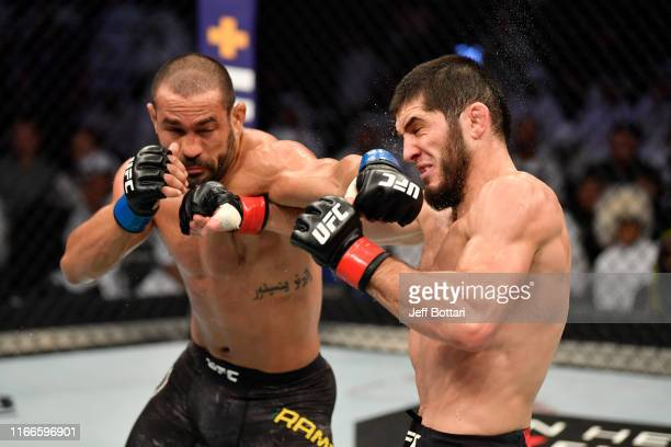 Davi Ramos of Brazil punches Islam Makhachev of Russia in their lightweight bout during UFC 242 at The Arena on September 7 2019 in Yas Island Abu...