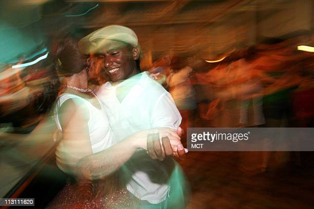 Davi Santos dances with Renata Neder left at a samba club in the Lapa district of Rio de Janeiro January 14 2006 In place of Americanstyle rock music...