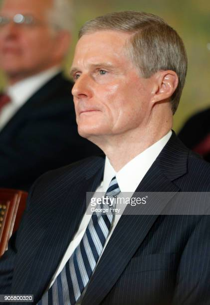 David A Bednar a member of the Quorum of the Twelve Apostles listens to President Russell M Nelson of the Church of Jesus Christ of Latter Day Saints...