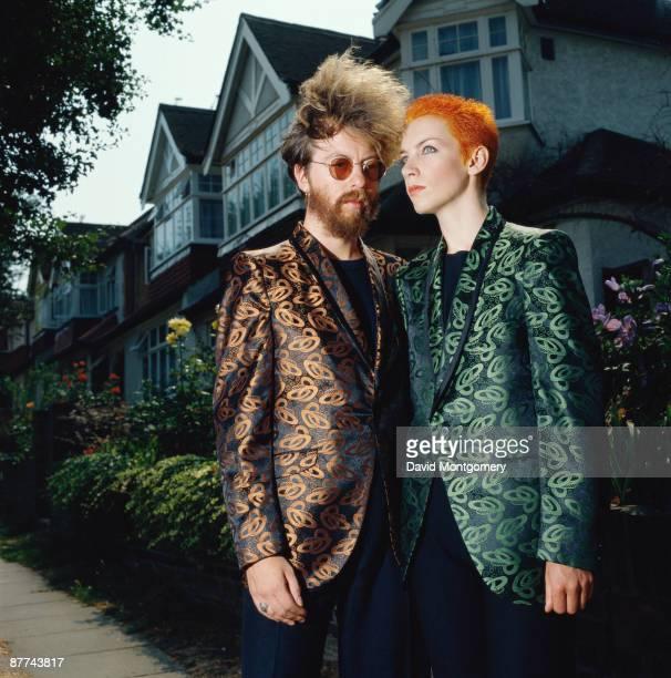 David A Stewart and Annie Lennox of British synth pop duo Eurythmics on a suburban street London circa 1985