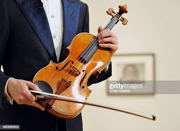 David Aaron Carpenter the virtuoso violist holds the Macdonald viola by Antonio Stradivari made in 1719 at Sotheby's March 27 2014 in New York...