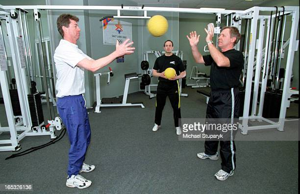 David Ablack in middle with Bruce Johnston on left in lighter clothes and Herb Feller on rt in black clothesworking on shoulder stabilization and...