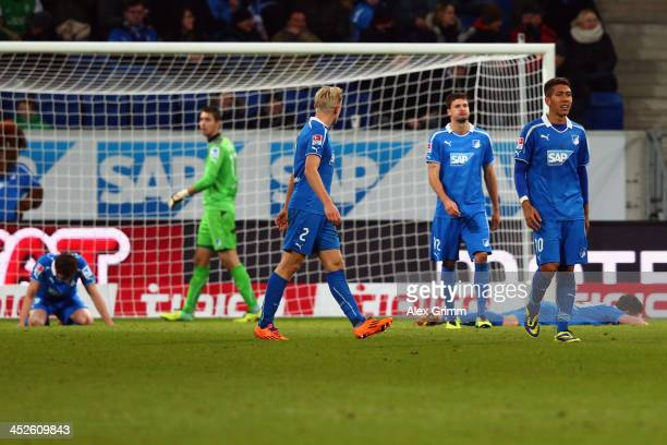 David Abraham goalkeeper Koen Casteels Andreas Beck Tobias Strobl and Roberto Firmino of Hoffenheim react after Philipp Bargfrede of Bremen scored...