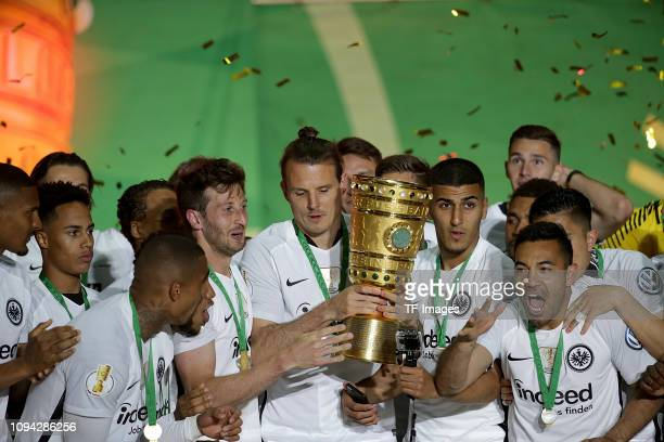 David Abraham of Eintracht Frankfurt and Alexander Meier of Eintracht Frankfurt show the trophy at the celebration ceremony after winning the DFB Cup...