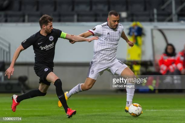 David Abraham of Eintracht Frankfurt and Arthur Cabral of FC Basel 1893 battle for the ball during the UEFA Europa League round of 16 first leg match...