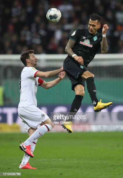 David Abraham of Eintracht Frankfurt and Davie Selke of SV Werder Bremen compete for a header during the DFB Cup quarterfinal match between Eintracht...
