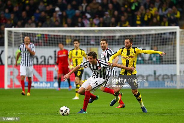 David Abraham of Eintracht Frankfurt and Gonzalo Castro Randon of Borussia Dortmund compete for the ball during the Bundesliga match between...