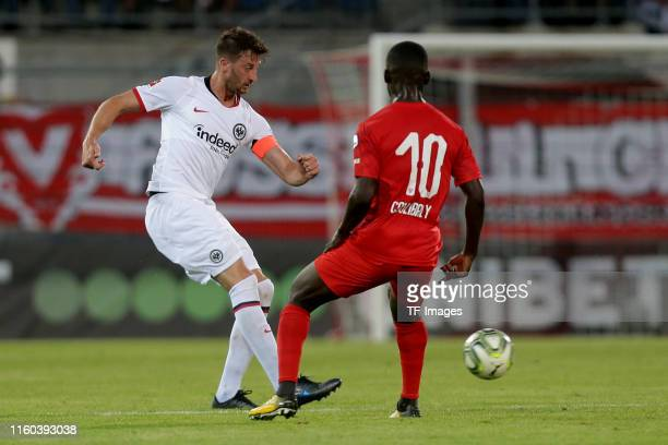 David Abraham of Eintracht Frankfurt and Mohamed Coulibaly of FC Vaduz battle for the ball during the UEFA Europa League Third Qualifying Round match...