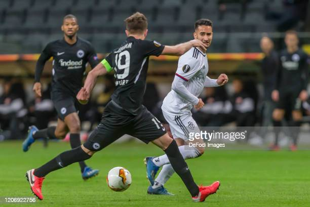 David Abraham of Eintracht Frankfurt and Samuele Campo of FC Basel 1893 battle for the ball during the UEFA Europa League round of 16 first leg match...