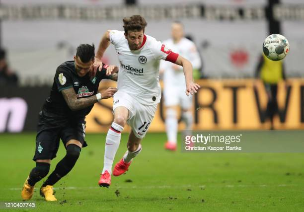 David Abraham of Eintracht Frankfurt tackles Davie Selke of SV Werder Bremen during the DFB Cup quarterfinal match between Eintracht Frankfurt and...