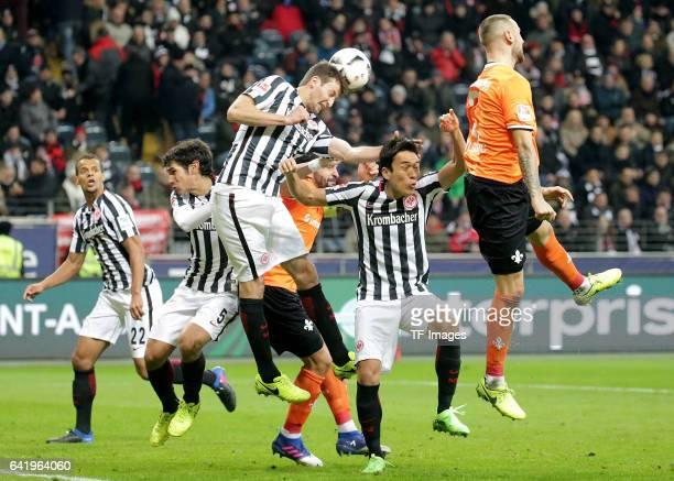 David Abraham of Frankfurt and Makoto Hasebe of Frankfurt and Alexander Milosevic of Darmstadt battle for the ball during the Bundesliga match...