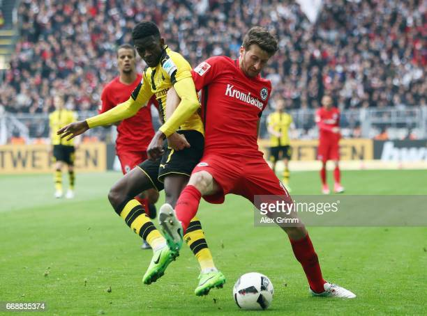 David Abraham of Frankfurt is challenged by Ousmane Dembele of Dortmund during the Bundesliga match between Borussia Dortmund and Eintracht Frankfurt...