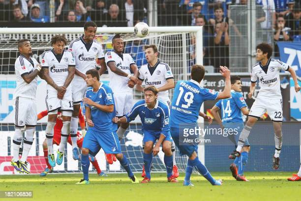 David Abraham of Hoffenheim scores his team's third goal with a freekick during the Bundesliga match between 1899 Hoffenheim and FC Schalke 04 on...