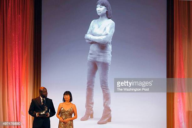 David Adjaye presents the the first American Portrait Prize to Maya Lin at the National Portrait Gallery November 15 2015 in Washington DC The...