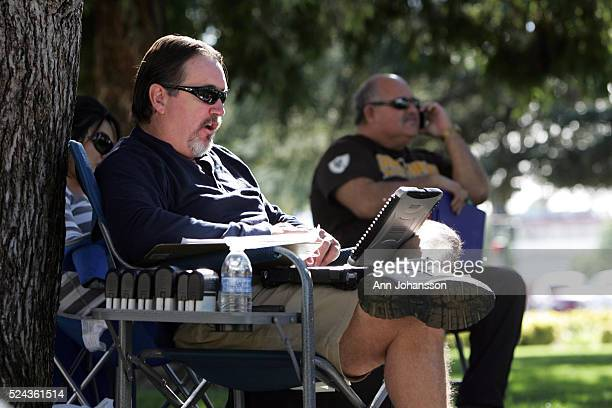 David Adragna left with Lenders Processing Services Inc auctions off foreclosed homes on the lawn in front of the court house in San Bernardino...