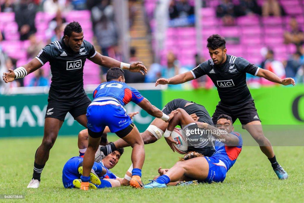 David Afamasaga of Samoa (R) tackles Luke Masirewa of New Zealand (C) during the HSBC Hong Kong Sevens 2018 match between New Zealand and Samoa on April 7, 2018 in Hong Kong, Hong Kong.