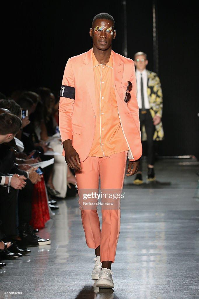 David Agbodji walks the runway at the 2015 amfAR Inspiration Gala New York at Spring Studios on June 16, 2015 in New York City.