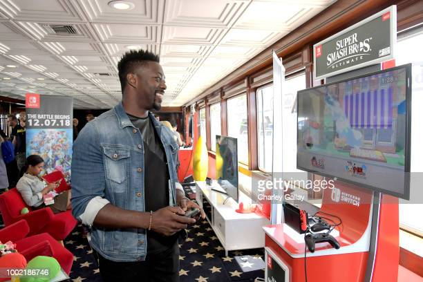 David Ajala tests his skills on Super Smash Bros Ultimate for Nintendo Switch at the Variety Studio at ComicCon 2018 on July 19 2018 in San Diego...