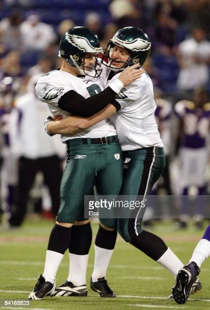 David Akers of the Philadelphia Eagles and Sav Rocca celebrate after Akers kicked a field goal late in the fourth quarter against the Minnesota...