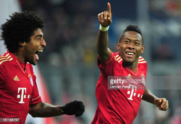 David Alaba and Dante of Muenchen celebrate the third goal during the Bundesliga match between FC Bayern Muenchen and FC Schalke 04 at Allianz Arena...