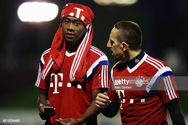 David Alaba and Franck Ribery leave the pitch during day 8 of the Bayern Muenchen training camp at ASPIRE Academy for Sports Excellence on January 16...