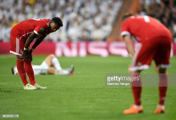 David Alaba and Franck Ribery of Bayern Muenchen look dejected during the UEFA Champions League Semi Final Second Leg match between Real Madrid and...