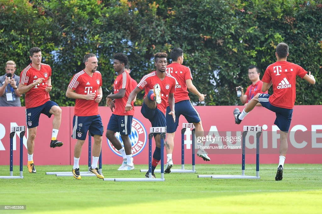 David Alaba #27 and Franck Ribery #7 of FC Bayern Muenchen trains during an International Champions Cup FC Bayern training session at Geylang Field on July 24, 2017 in Singapore.