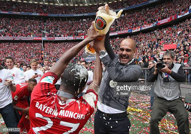 David Alaba and head coach Pep Guardiola of Bayern Muenchen fight with a beer mug to celebrate the German Championship after the Bundesliga match FC...