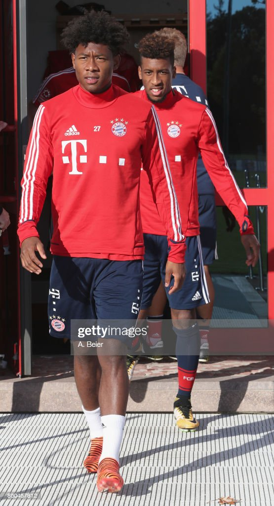David Alaba (L) and Kingsley Coman of FC Bayern Muenchen arrive for a training session at the Saebener Strasse training ground on October 12, 2017 in Munich, Germany.