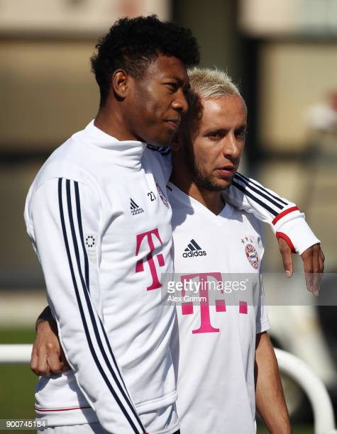 David Alaba and Rafinha arrive for a training session on day 2 of the FC Bayern Muenchen training camp at ASPIRE Academy for Sports Excellence on...