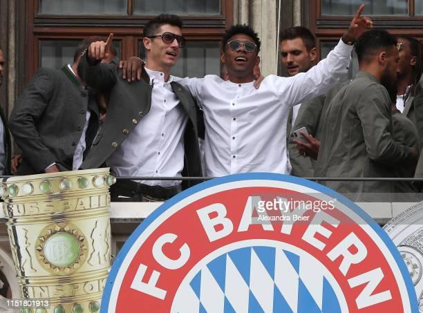 David Alaba and Robert Lewandowski of FC Bayern Muenchen celebrate winning the Bundesliga title and the German Cup title for the season 2018/19 on...