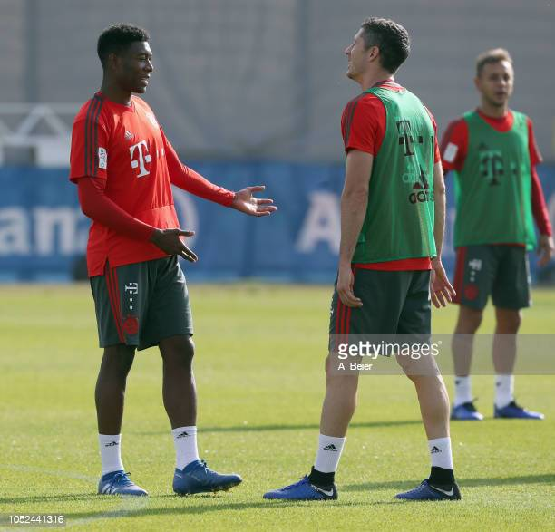 David Alaba and Robert Lewandowski of FC Bayern Muenchen chat during a training session at the club's Saebener Strasse training ground on October 18...