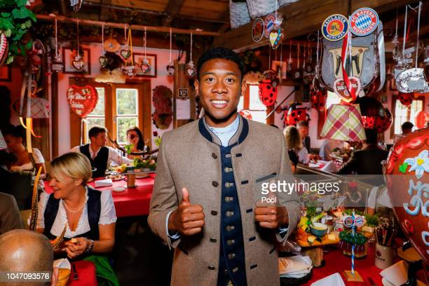 David Alaba attends the Oktoberfest beer festival at Kaefer Wiesenschaenke tent at Theresienwiese on October 7 2018 in Munich Germany