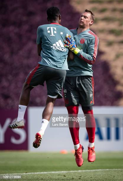 David Alaba celebrates with MAnuel Neuer during a training session at day five of the Bayern Muenchen training camp at Aspire Academy on January 07...