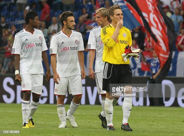David Alaba Diego Contento Maximillian Haas and Rouven Sattelmeier of Bayern look dejected after losing 13 the LIGA total Cup 2010 final match...
