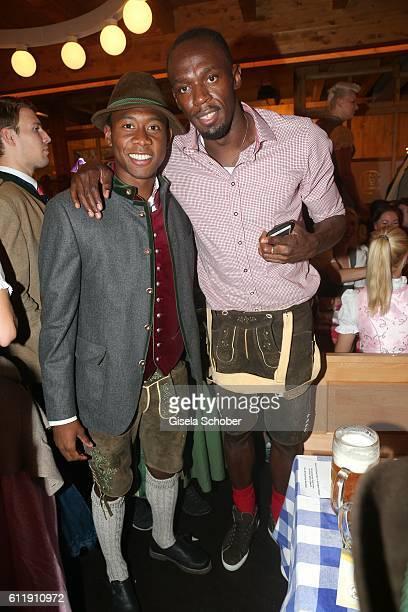 David Alaba FC Bayern soccer player and Usain Bolt sprinter ninefold olympic champion and elevenfold world champion during the Oktoberfest at...