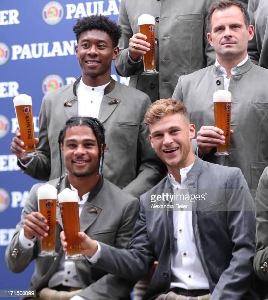 David Alaba goalkeeper coach Toni Tapalovic Joshua Kimmich and Serge Gnabry of FC Bayern Muenchen pose with beer mugs during the FC Bayern Muenchen...