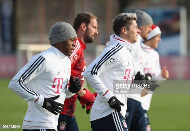 David Alaba goalkeeper Tom Starke Robert Lewandowski Sandro Wagner and Joshua Kimmich of FC Bayern Muenchen warm up during a training session at the...