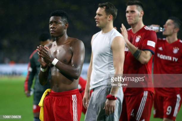 David Alaba Manuel Neuer Niklas Suele and Robert Lewandowski of Muenchen react after the Bundesliga match between Borussia Dortmund and FC Bayern...