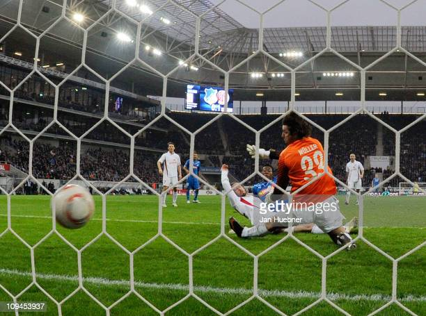David Alaba of 1899 Hoffenheim scores the 11 goal against Christian Fuchs and Heinz Mueller of FSV Mainz 05 during the Bundesliga match between 1899...