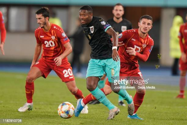 David Alaba of Austria and Enis Bardi of North Macedonia during the UEFA Euro 2020 Qualifier between Austria and North Macedonia on November 16, 2019...