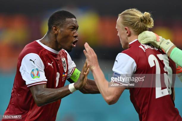 David Alaba of Austria celebrates their side's victory with team mate Xaver Schlager after the UEFA Euro 2020 Championship Group C match between...