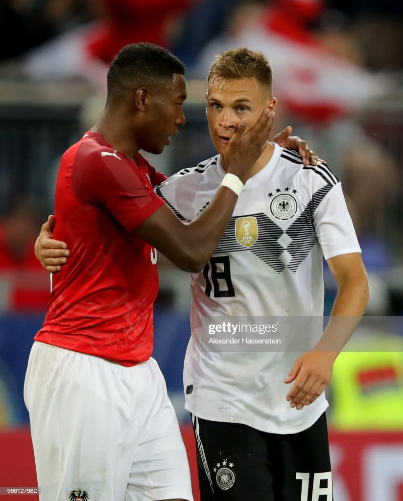 David Alaba (L) of Austria comforts Joshua Kimmich of Germany after the International Friendly match between Austria and Germany at Woerthersee Stadion on June 2, 2018 in Klagenfurt, Austria.