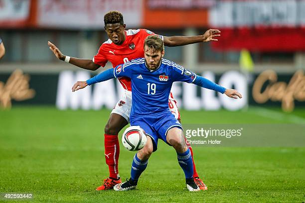 David Alaba of Austria competes for the ball with Niklas Kleber of Liechtenstein during the UEFA EURO 2016 Qualifier between Austria and...