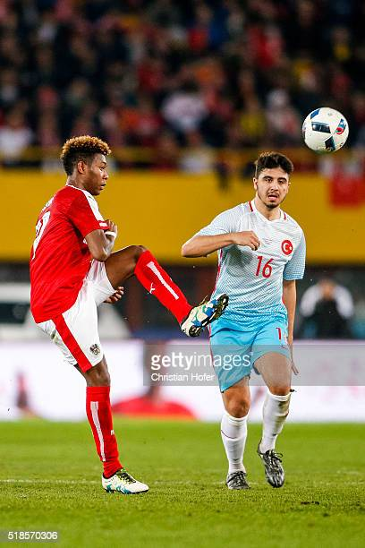 David Alaba of Austria competes for the ball with Ozan Tufan of Turkey during the international friendly match between Austria and Turkey at...