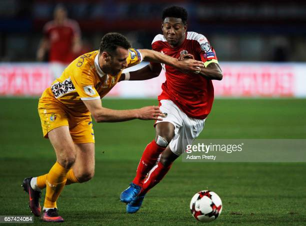 David Alaba of Austria is challenged by Victor Golovatenco of Moldova during the Austria v Moldavia 2018 FIFA World Cup Qualifier match at Ernst...