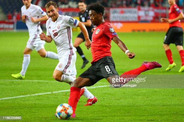 David Alaba of Austria kicks the ball during the UEFA Euro 2020 Qualifier match between Austria and Latvia at Red Bull Arena on September 6 2019 in...